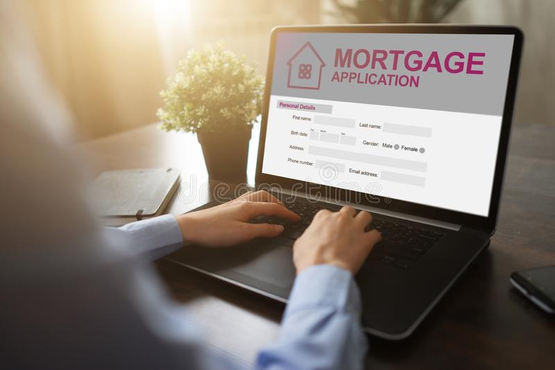 Online mortgage application on screen. Property loan. Business and financial concept. stock photography