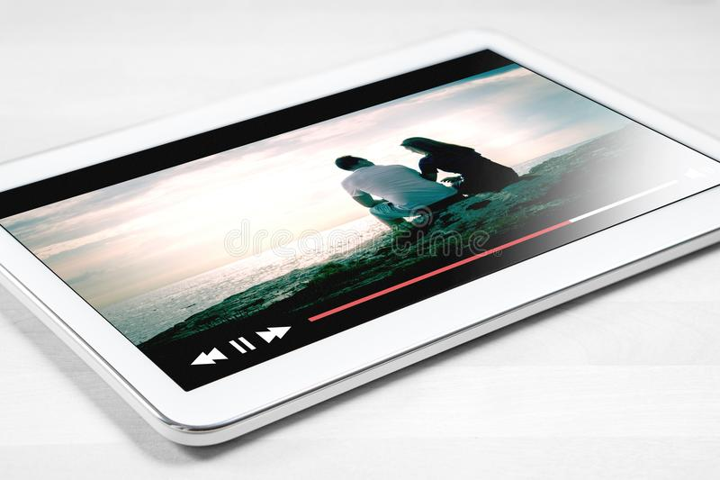 Online movie stream with mobile device royalty free stock images