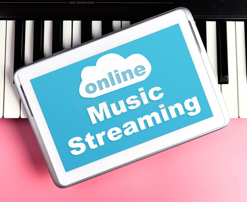 Online Music Streaming poster on tablet keyboard stock photo