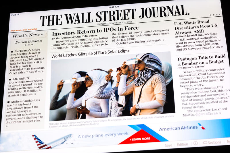 Online Newspaper Edition. BUCHAREST, ROMANIA - NOVEMBER 04, 2013: The Wall Street Journal Newspaper On Apple iPad Tablet. Is an American international daily stock image
