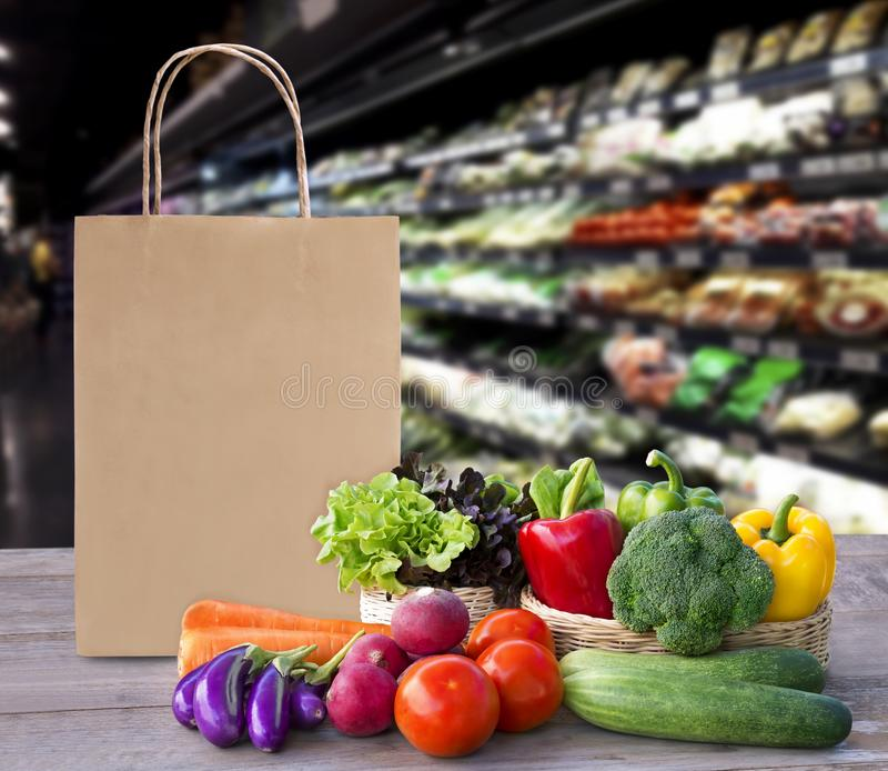 Online order grocery shopping concept. Food delivery ingredients service at home for cooking with packages bag on wood table on. Supermarket background for royalty free stock images