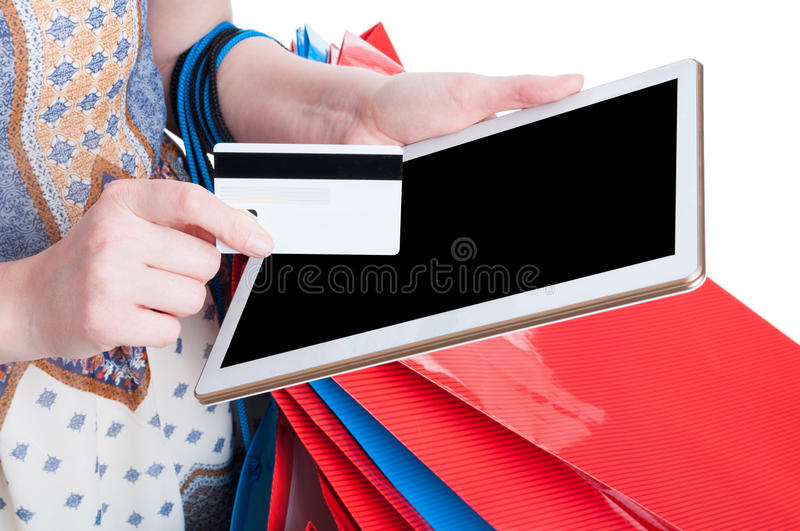 Online payment concept with tablet and debit card in close-up stock image