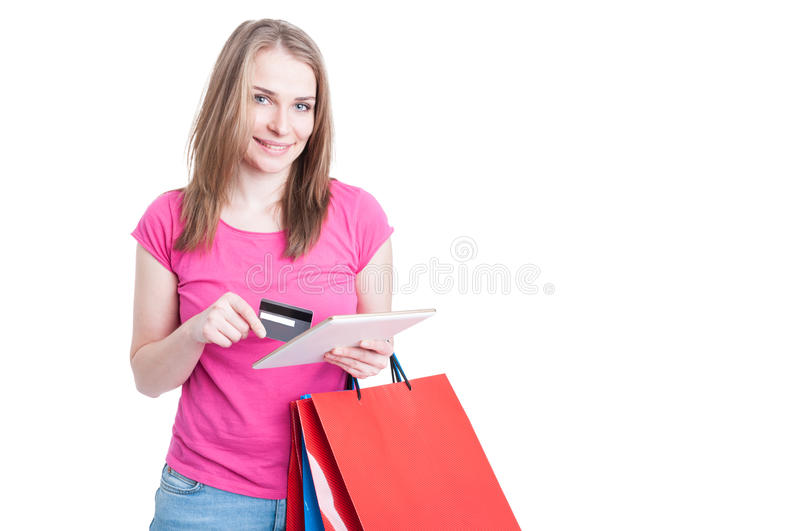 Online payment concept with young woman doing shopping stock photo