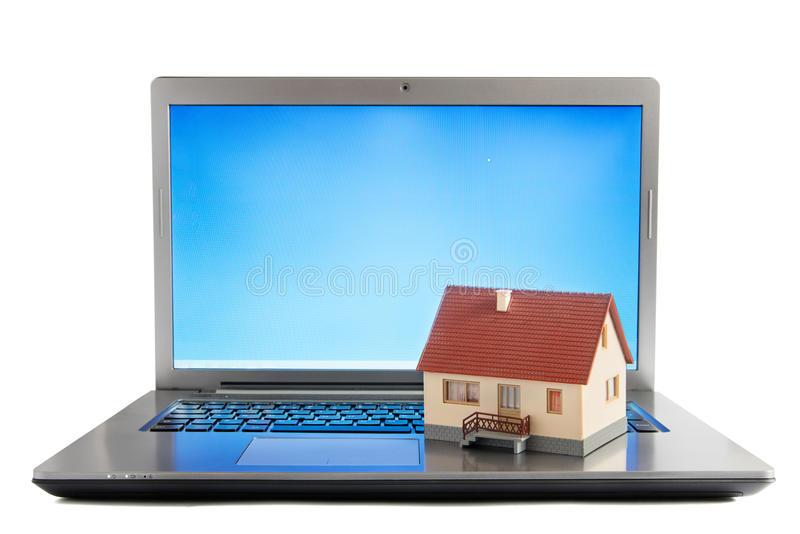 Online real estate business. House on laptop computer royalty free stock images