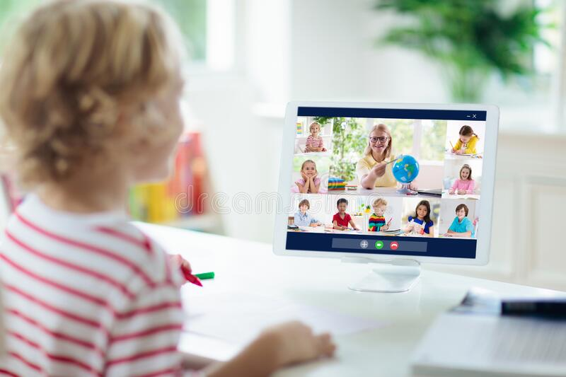 Online remote learning. School kids with computer. Having video conference chat with teacher and class group. Child studying from home. Homeschooling during stock photos