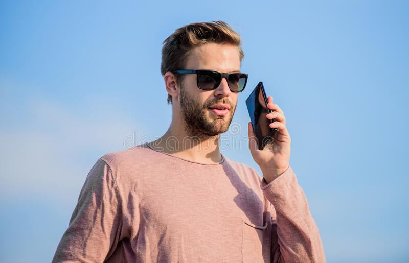 Online reservation. modern technology in life. always in touch. macho man use mobile phone. confident man speak on phone stock image