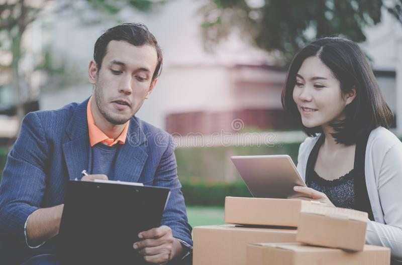 Online retailer working outdoor shipping to customer stock photography