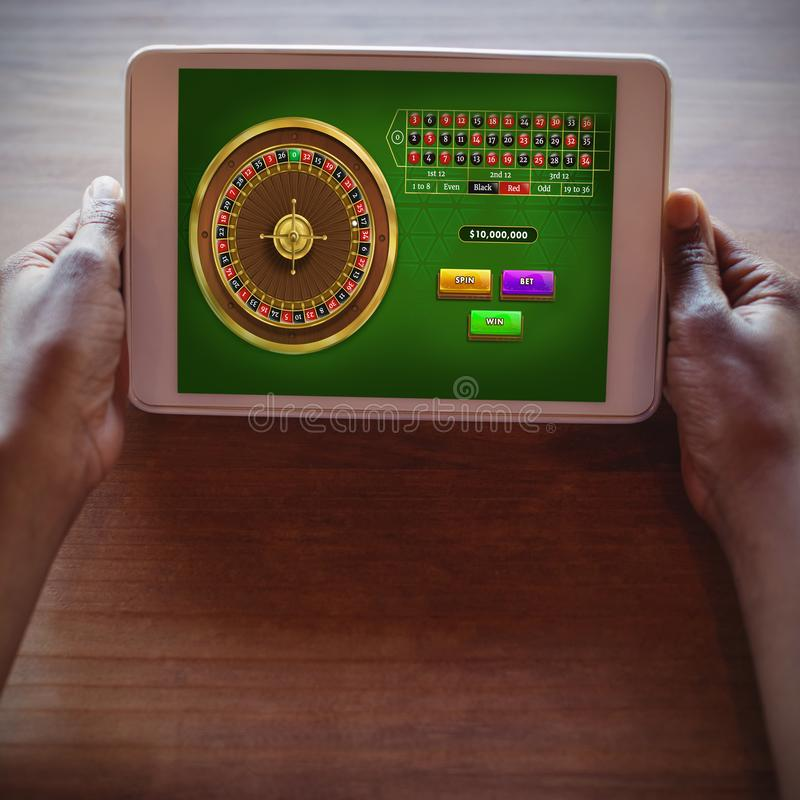 Composite image of online roulette game stock photos