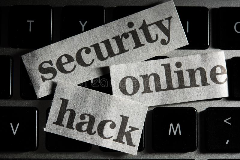 Online Security Concept with cut out words from newspaper. An Online Security Concept with cut out words from newspaper, newspring royalty free stock photos