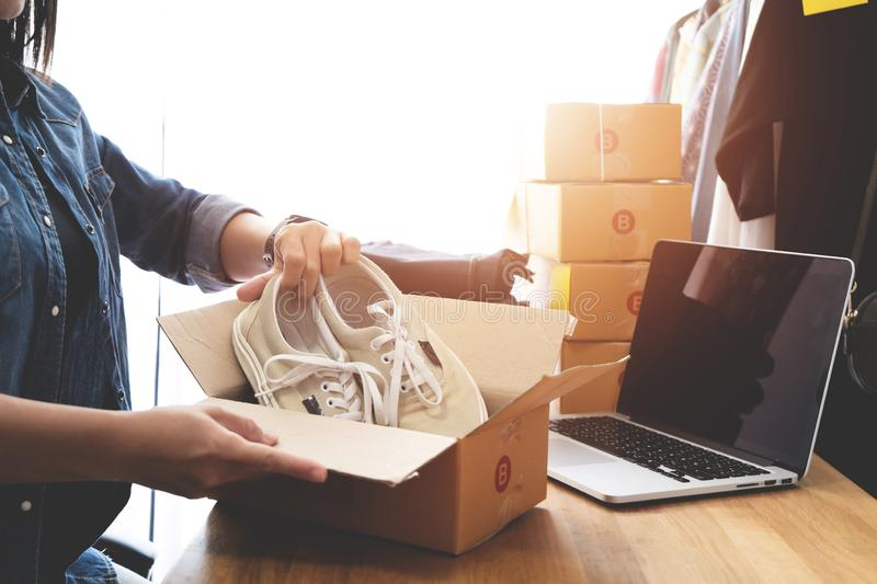 Online selling e-commerce shipping idea concept, Women freelance start up small business. Owner packing cardboard box at workplace royalty free stock images