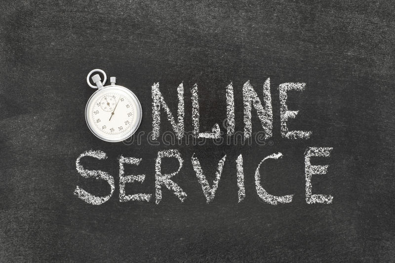 Online service watch. Online service phrase handwritten on chalkboard with vintage precise stopwatch used instead of O royalty free stock image