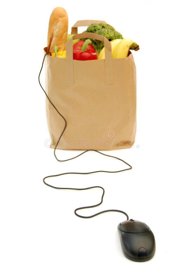 Online shopping. Computer mouse attached to a bag of groceries stock image