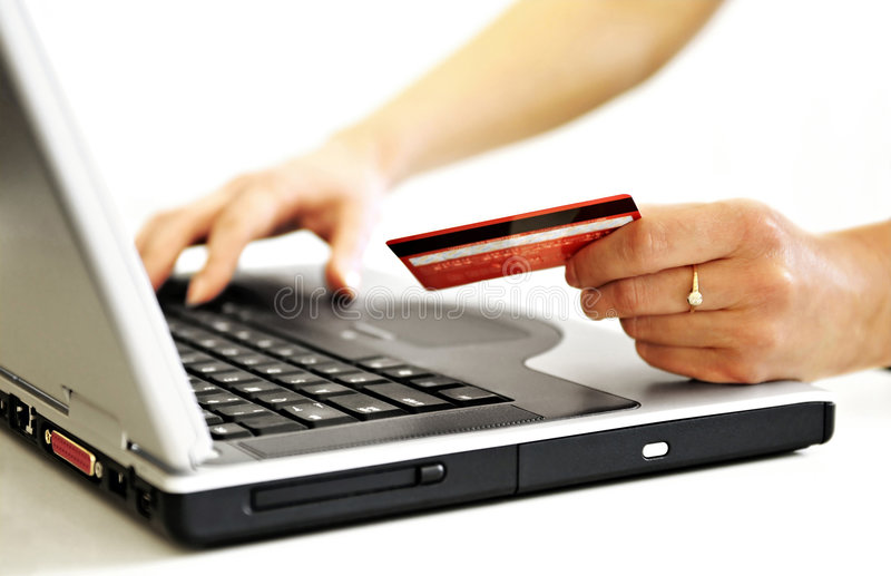 Online Shopping. Very shallow DOF! Focus on the hand and on the card