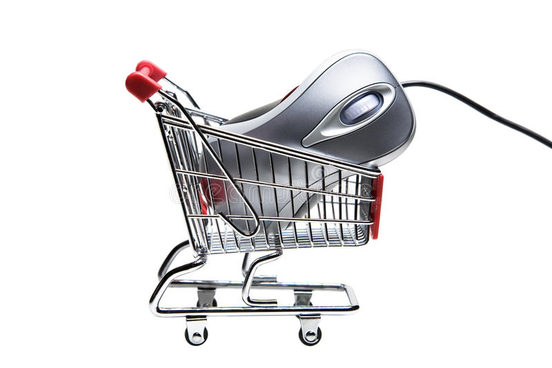 Online shopping. Metallic color computer mouse placed in a miniature-shopping cart royalty free stock photography