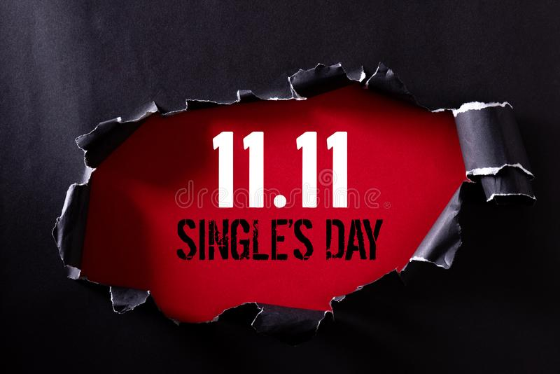 Online shopping of China, 11.11 single`s day sale concept. Top view of Black torn paper and the text 11.11 single`s day sale on. A red background royalty free stock photos