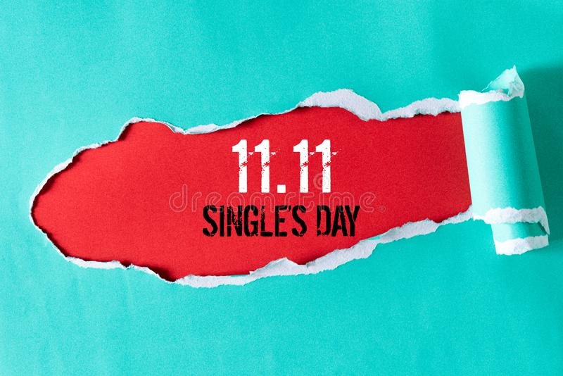 Online shopping of China, 11.11 single`s day sale concept. Top view of green pastel torn paper and the text 11.11 single`s day. Sale on a red background stock image