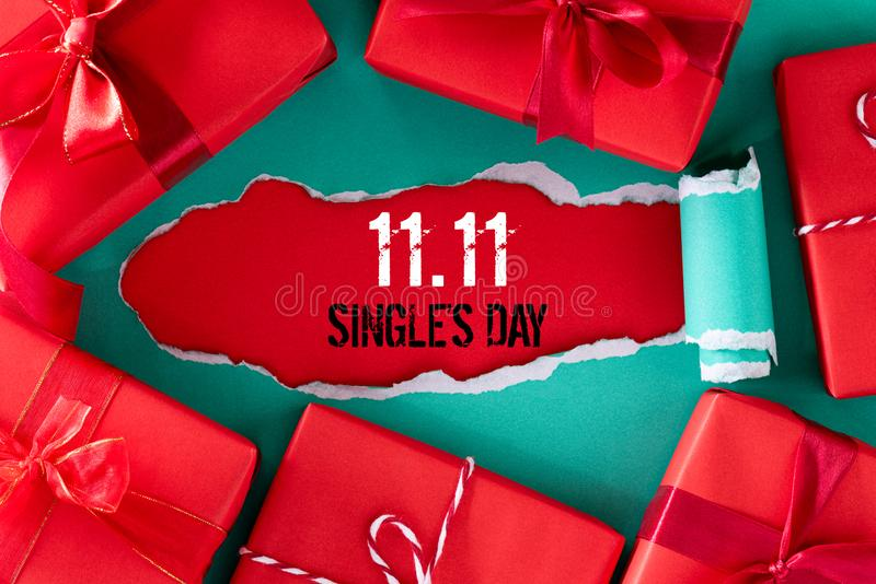 Online shopping of China, 11.11 single`s day sale concept. Top view of green pastel torn paper and the text 11.11 single`s day. Sale on a red background stock photography
