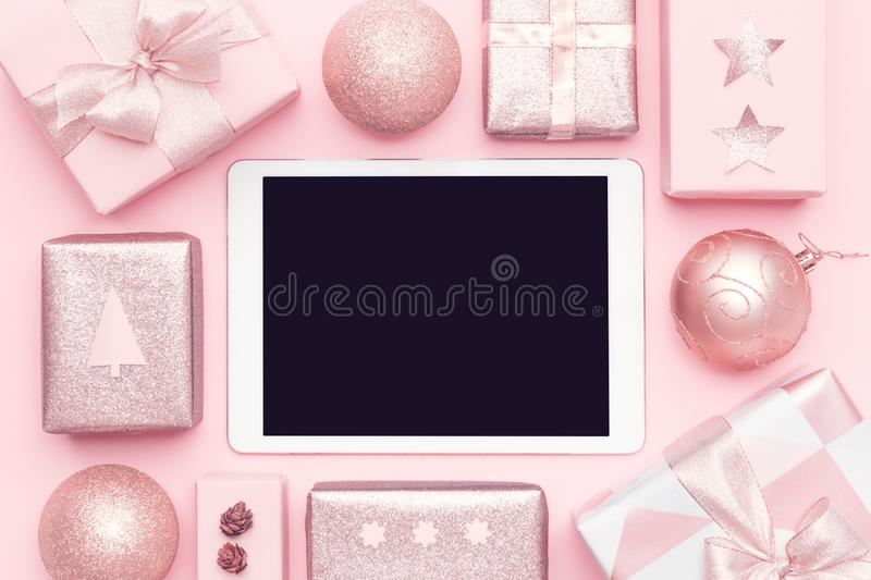 Online Christmas Shopping. Boxing Day Sale Background. Wrapped christmas presents and blank screen digital tablet. stock images