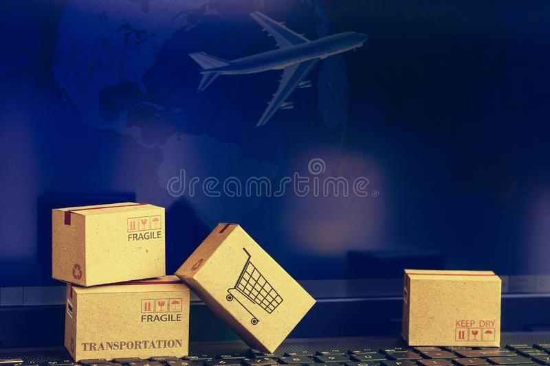 Online shopping concept of cardboard boxes packing on notebook k. Eyboard. business ideas about transportation, global shipping, international freight, overseas stock images