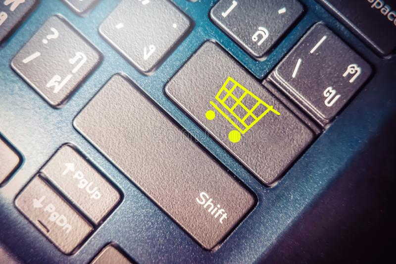 Online Shopping concept, close up button with shopping cart icon on keyboard royalty free stock photos