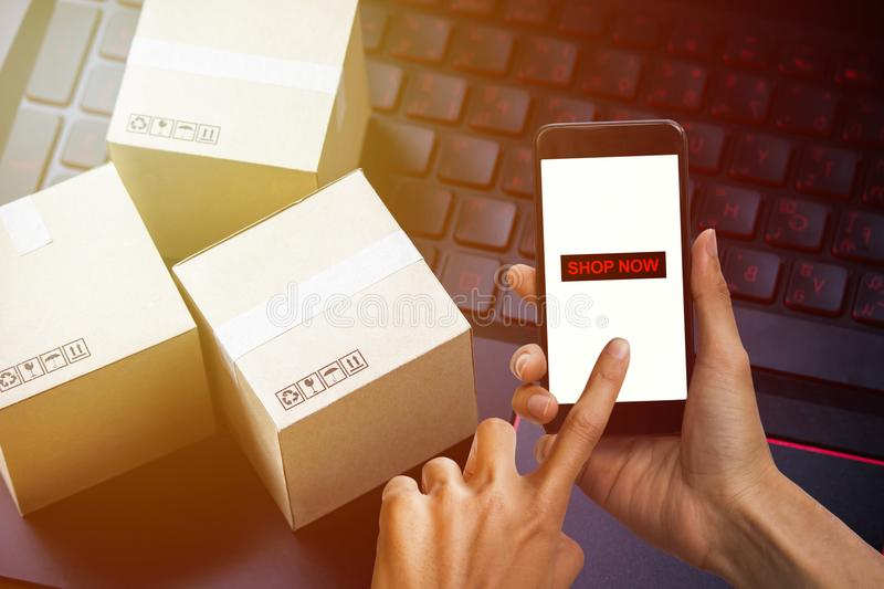 Online shopping concept e-commerce delivery buying service. square cartons shopping on laptop keyboard, showing customer order vi royalty free stock images