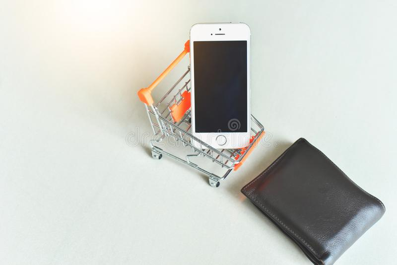 Mini Shopping Cart with Smartphone and Wallet stock photos