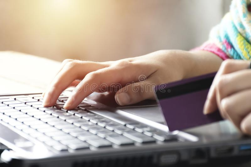Online shopping concept . Women are buying online with a credit. Card. Online Shopping Website on Laptop stock photography