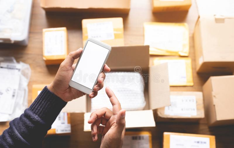 Online shopping concepts with youngman using smartphone on a lot of package box.Ecommerce market.Transportation logistic royalty free stock photos