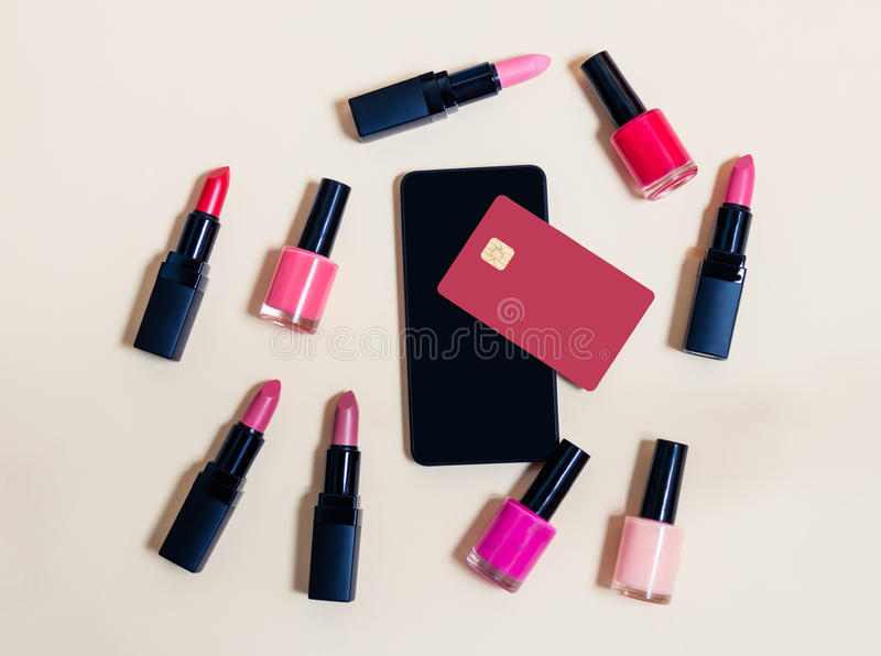 Online shopping cosmetics concept. Beige background. Top view royalty free stock photography