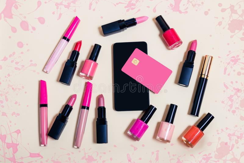 Online shopping cosmetics concept. Top view. Online shopping cosmetics concept on beige background. Top view stock image