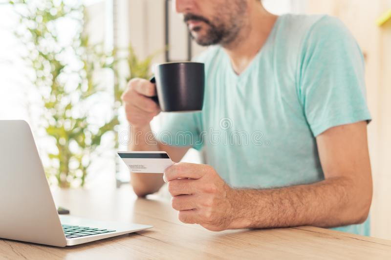 Online shopping with credit card and laptop computer royalty free stock image