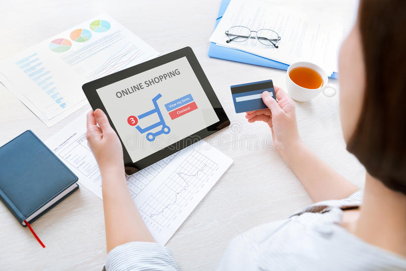 Online shopping with digital tablet stock photos