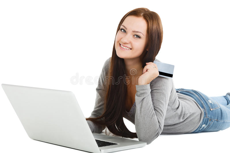 Online Shopping. Happy Smiling Woman Using Credit Card to Intern. Et Shop on-line. Young woman with Laptop Computer and Credit Card buying online stock photo