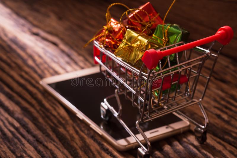 Online shopping and internet e-commerce concept. Trolley for sup stock image