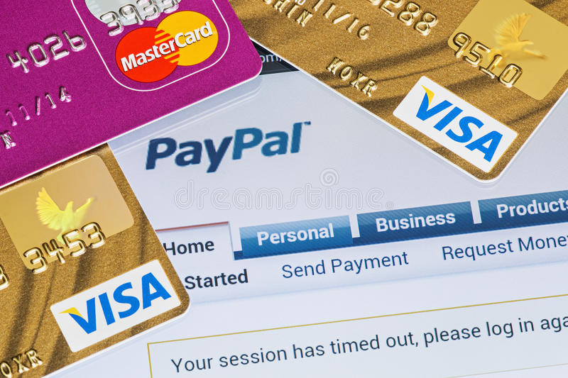 Online shopping paid via Paypal payments. Moscow, Russia - February 27, 2014: Online shopping paid via Paypal payments using plastic cards Visa and Mastercard stock image