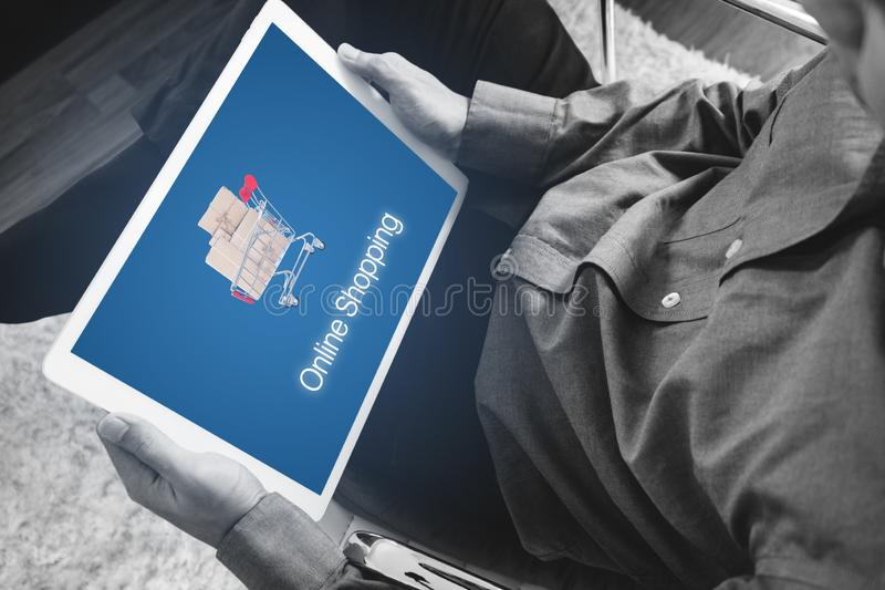 Online shopping and online retailer business. a man using digital tablet for shopping and selling online royalty free stock photos