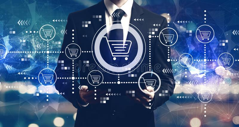 Online shopping theme with businessman holding a tablet royalty free stock image