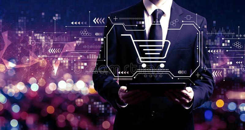 Online shopping theme with businessman holding a tablet royalty free stock photo
