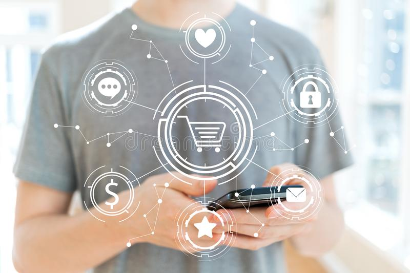 Online Shopping Theme with man using a smartphone stock image