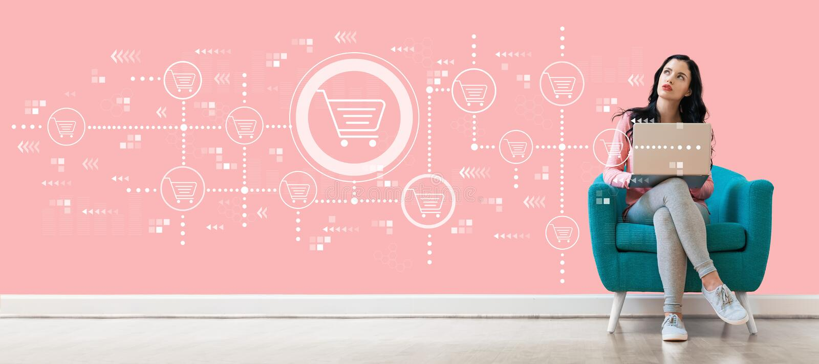 Online shopping theme with woman using a laptop stock photo