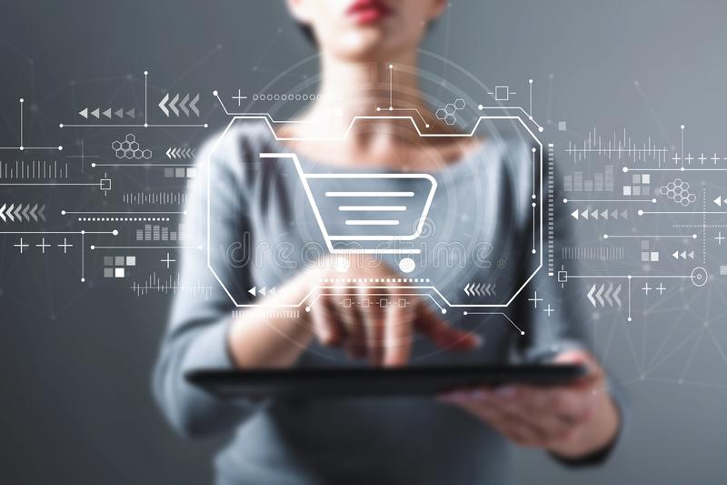 Online shopping theme with woman using a tablet royalty free stock images