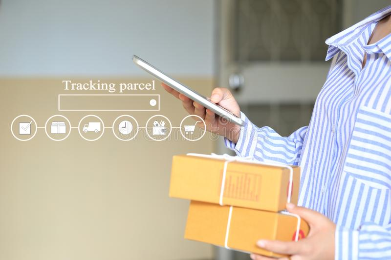 Online shopping, Woman hand holding smart phone and tracking parcel online to update status with hologram, Ecommerce and delivery stock photography