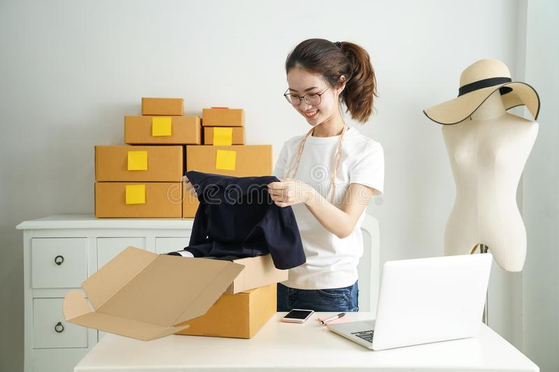 Online small business owner, Young business start up online seller owner using computer for checking the customer orders from emai. L or website and preparing royalty free stock photography