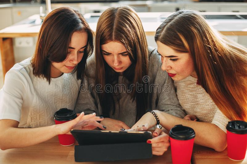 Students read carefully their task at tablet pc stock photography