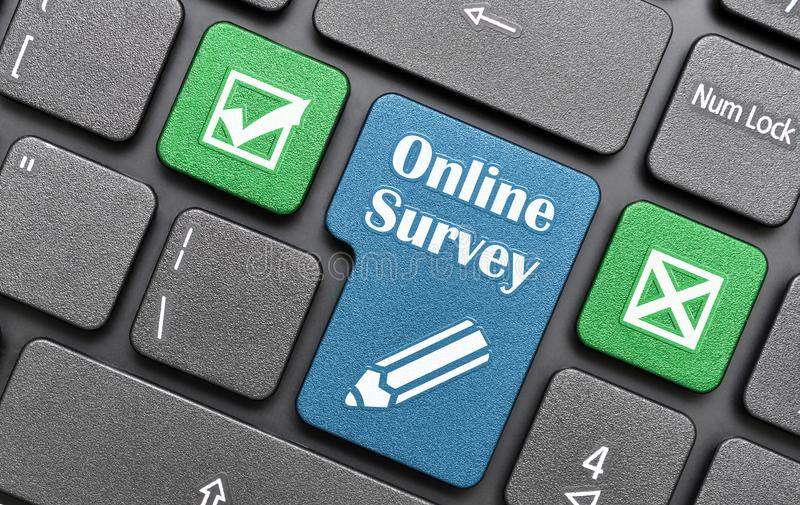 Online survey. Green and blue online survey key on laptop