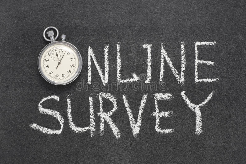 Online survey watch. Online survey phrase handwritten on chalkboard with vintage precise stopwatch used instead of O royalty free stock image