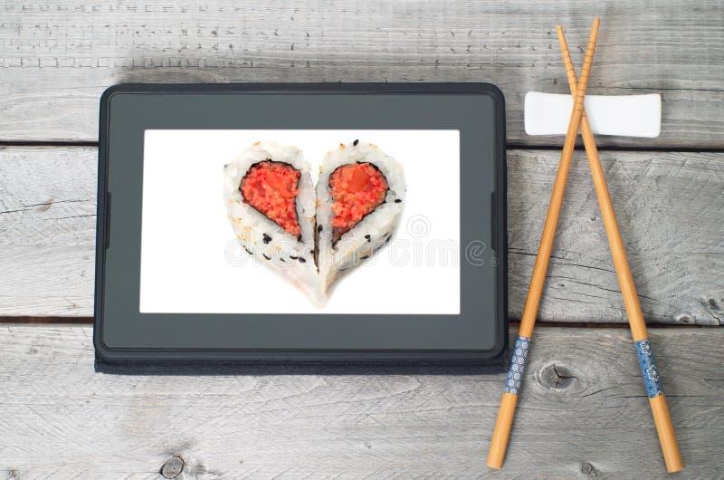 Online-sushi som beställer begrepp royaltyfri bild
