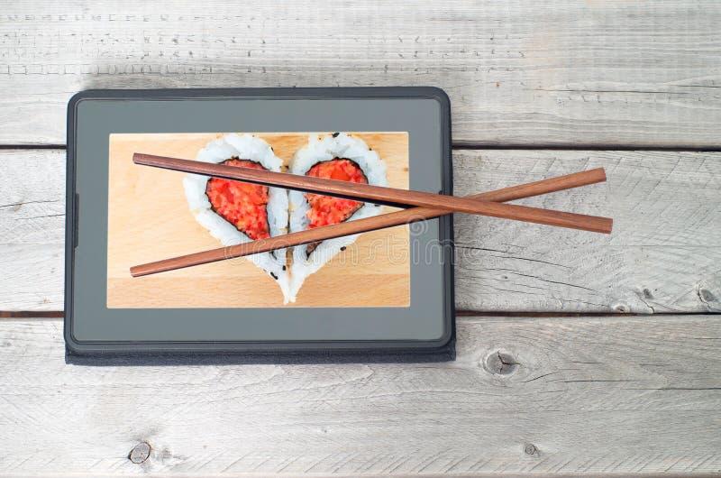 Online-sushimat som beställer begrepp arkivfoto