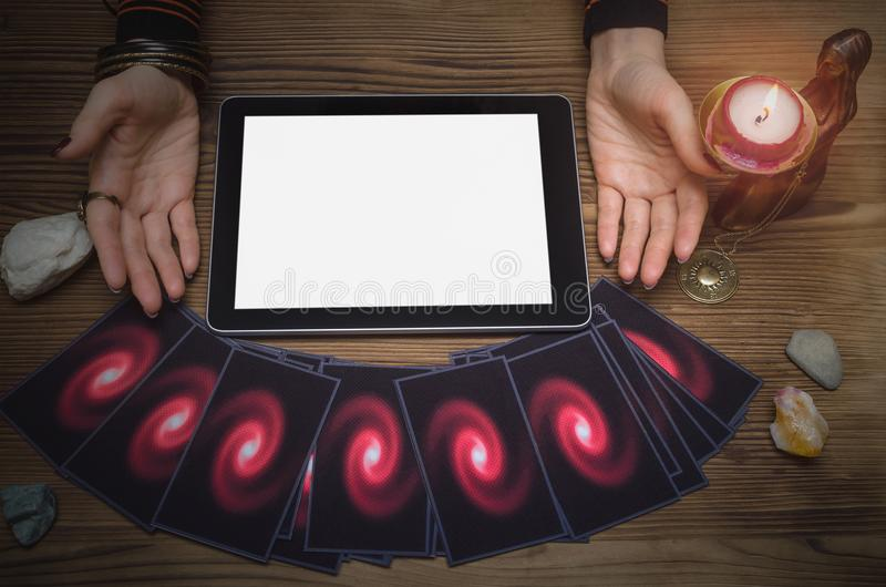 Tarot cards deck. Future reading. Fortune teller. The psychic. Online tarot cards reading mock up. Future reading in internet concept. Fortune teller showing a royalty free stock image