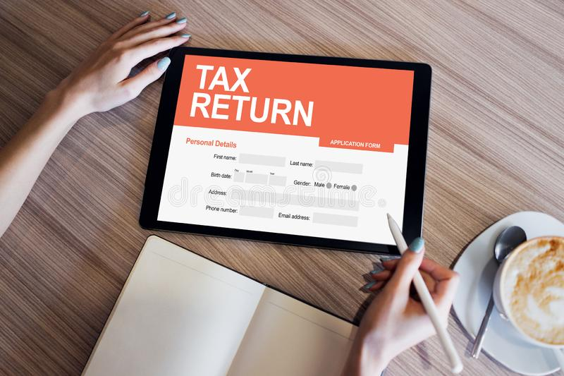 Online tax return application on screen. Business and finance concept. Online tax return application on screen. Business and finance concept royalty free stock image